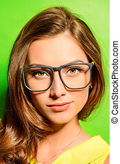 look through glasses - Beauty portrait of a positive young...