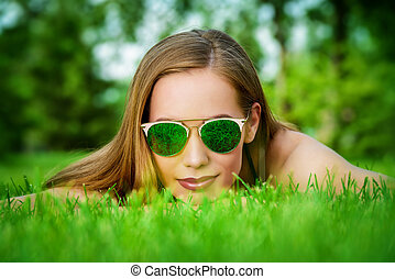 look through grass - Carefree summer day. Pretty young woman...