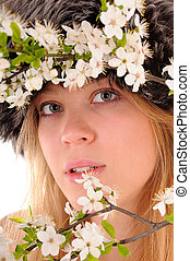 Look through spring flowers - Winter beauty woman looks...
