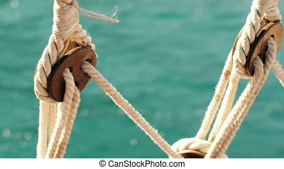 Look Through the Ropes of Ship at Sea - view from the stern...