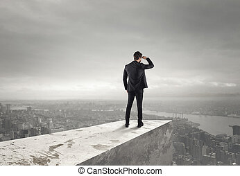 Look to the future - Businessman looks at the city from the...