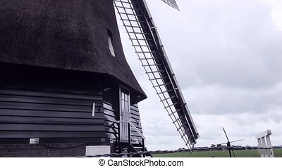 Look to the wings of the windmill.2 - Waterwindmill in...