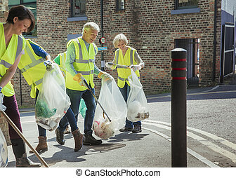 Looking After the Environment - A group of five people...