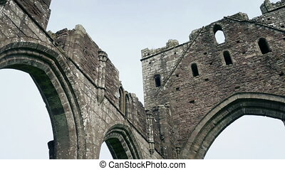 Looking Around Arches Of Medieval Ruins - Panning shot...