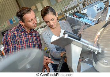 looking at a ham slicing machine