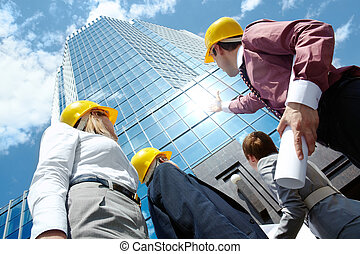 Looking at building - Below view of business partners in...