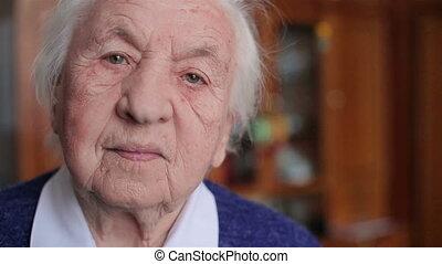Looking at camera old woman