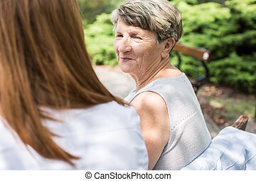 Looking at daughter - Elder lady is looking at her daughter