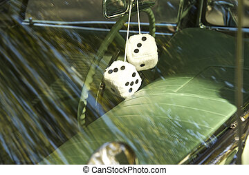 Looking at fuzzy dice through the window of a 1957 luxury ...