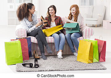 Looking at her latest shopping treasures