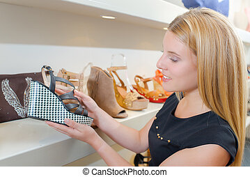 Looking at new shoes in a shop