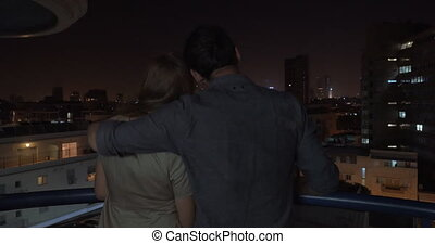 Looking at night city being in the hugs of loving man