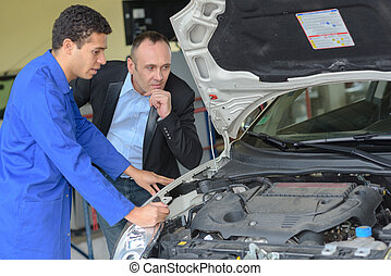 looking at the car's engine