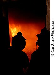 Looking At The Fire - Firefighters looking through the door...