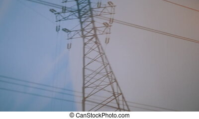 Looking at transmission tower from moving train - Electrical...
