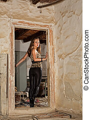 Looking back - Young woman looking back and entering a ...