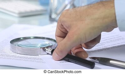 looking contract and hand signature - looking through a...