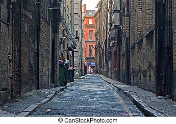 Looking down an empty inner city alleyway