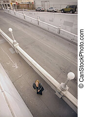 Looking Down at a Woman on the Sidwalk - Wide shot from...