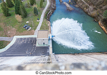 Looking down from the wall of a dam to the overflow