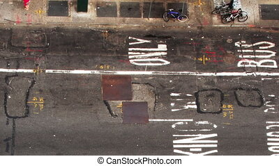 looking down onto manhattan street scene with traffic and...