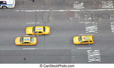 looking down onto manhattan street scene with traffic and people, nyc, america