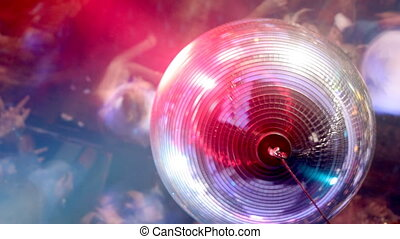 looking down past a discoball onto a large crowd on the dancefloor at a london nightclub
