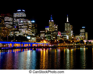 Looking down the Yarra river at Melbourne lights at night -...