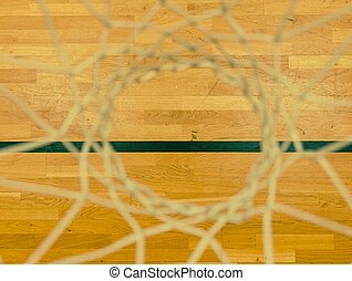 Looking down through  basketball hoop, playing fith DOF. Basketball hoop in the sports hall.