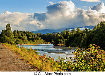 Looking downstream on the Kitimat River in the evening sun, British Columbia, Canada.