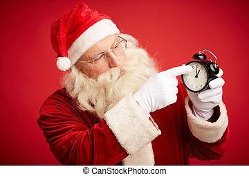 Looking for Christmas - Santa Claus pointing at alarm clock...
