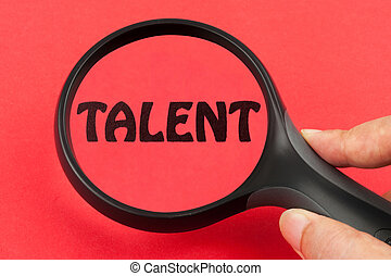 Looking for talent concept with a magnifier on hand