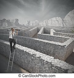 Looking for the solution to the maze - Businessman looking ...