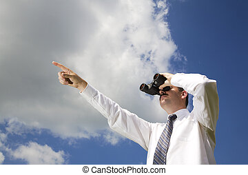 Businessman is looking ahead through binoculars with sky in the background