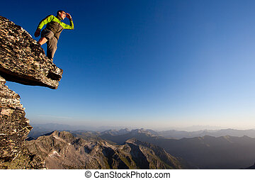 Looking forward. Young man overlooking mountain range