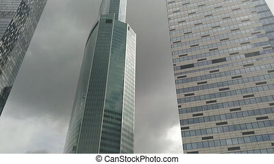 Looking from moving vehicle at skyscrapers - Looking up from...