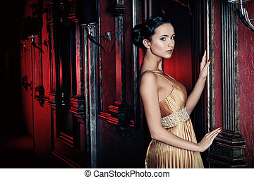 looking glass - Beautiful young woman in a luxurious classic...