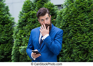 Looking great. agile business. bearded man on business meeting. using modern technology. modern look of ceo. responding email. always online. charismatic businessman with smartphone