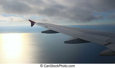 looking on wing and sea from airplane