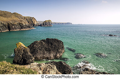 Looking out to sea from beautiful rocky cove on English Cornish coast