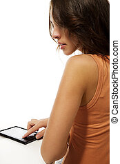looking over the shoulder of a beautiful woman reading ebook on white background