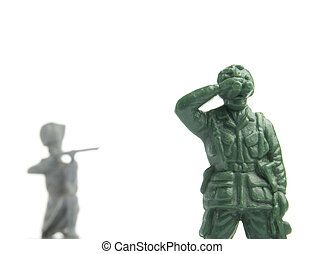 looking the wrong way - two toy soldiers, one is looking...