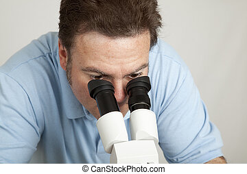 Looking Through Microscope