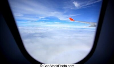 Looking through window aircraft during flight in wing with a nice blue sky. HD. 1920x1080