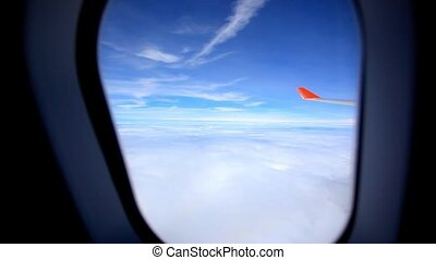 Looking through windows aircraft during flight in wing with a nice blue sky. HD. 1920x1080