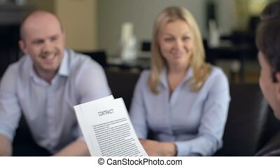 Looking Through Wording of Contract - Couple getting...