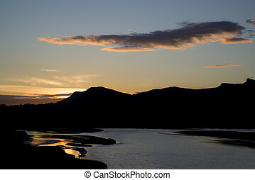 Looking towards Snowdonia mountain range from Porthamdog Cob during Summer sunset