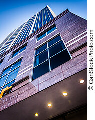 Looking up a modern building in downtown Wilmington, ...