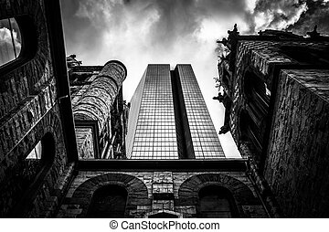 Looking up at a cathedral and the John Hancock Building in Boston, Massachusetts.