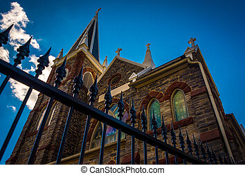 Looking up at a fence and St. Peter's Roman Catholic Church, in Harper's Ferry, West Virginia.